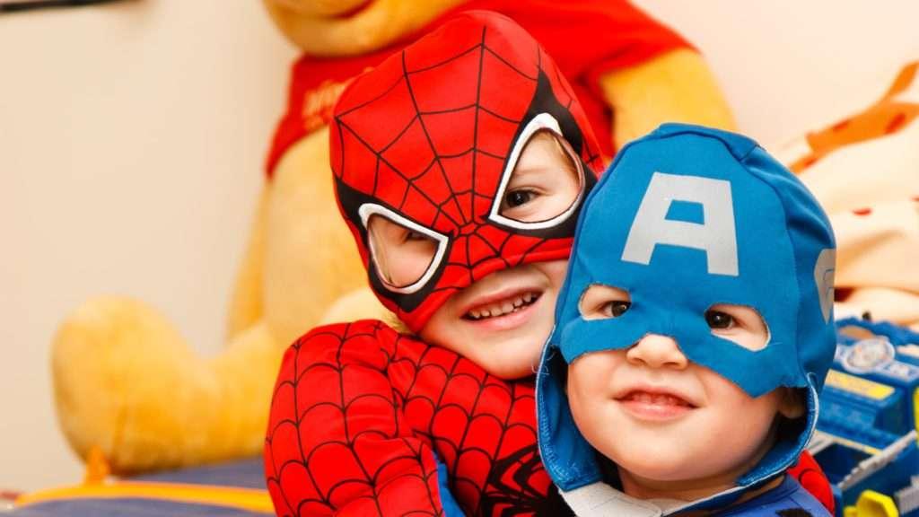 kids wearing superhero costumes