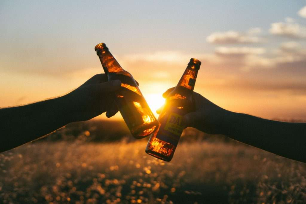 a toast with cold beer bottles
